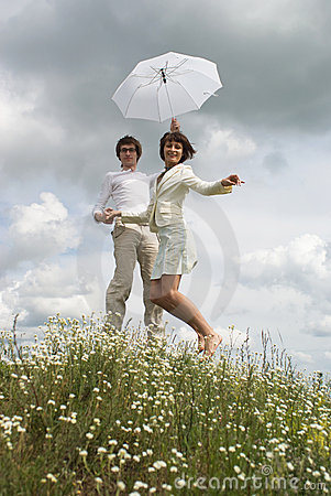 The woman  and man with  umbrella