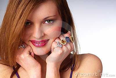 Beautiful young woman with luxury jewelry