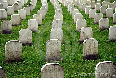 Old white tombstones in a cemetery.