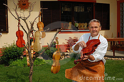 Violin builder and his workshop