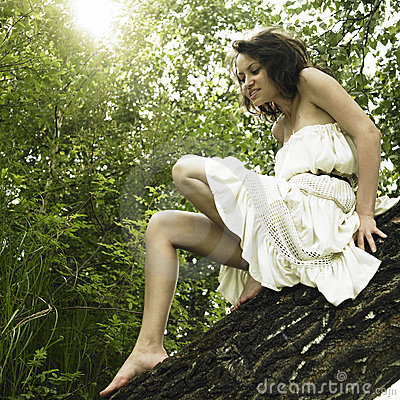 Young fine woman on tree