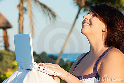 Lovely woman with laptop computer