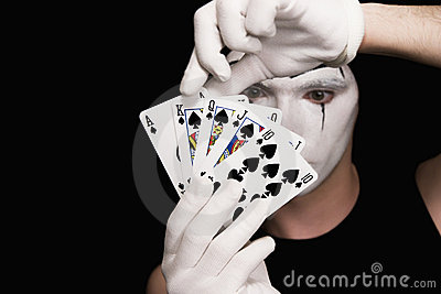 Mime with playing cards on  black background