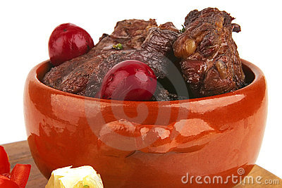 Beef meat in pot with vegetables