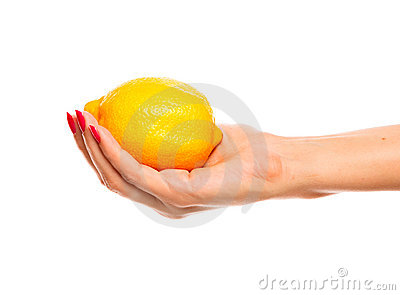 Human hand holding yellow lemon