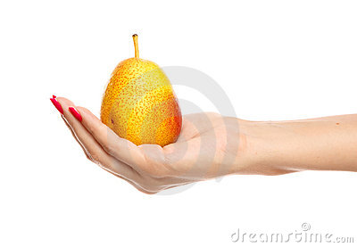 Human hand holding yellow pear