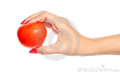 Human hand holding red tomato