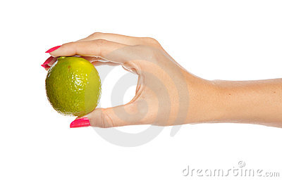 Human hand holding green lime