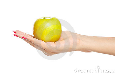 Human hand holding yellow apple