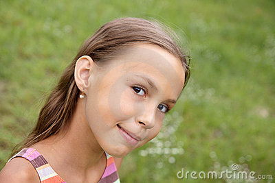 Preteen girl on grass background