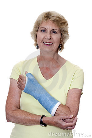 Senior woman holding left arm in cast