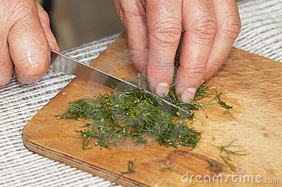 Cooking: woman hands cutting dill