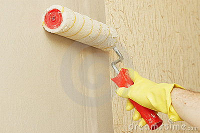 Hand in glothes lubricating wall