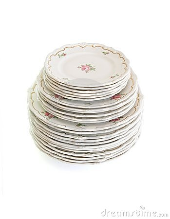 High stack of white dinner plates and saucers iso