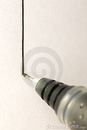 Pen drawing a black line on white paper
