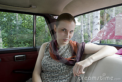 Beautiful girl on back sitting of the car