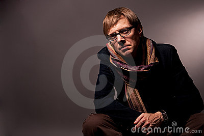 Man in glasses and scarf