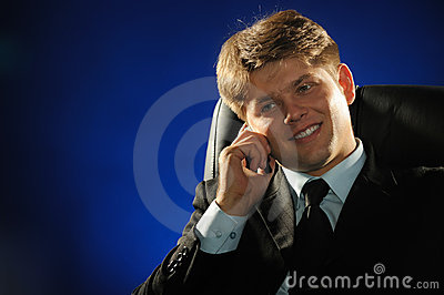The businessman talking by a mobile phone