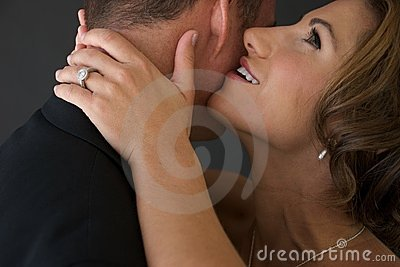 Bride Whispers into Groom's Ear