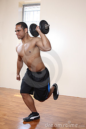 Male exercising, lifting dumbbell