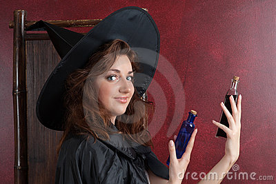 Young witch with potions