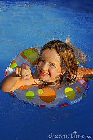 Little girl in pool pointing