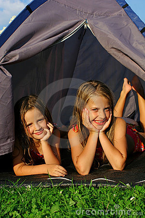 Two little girls camping