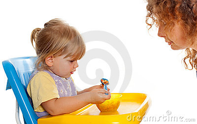 Eating little girl, young woman looking on it