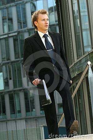Businessman walking with folder