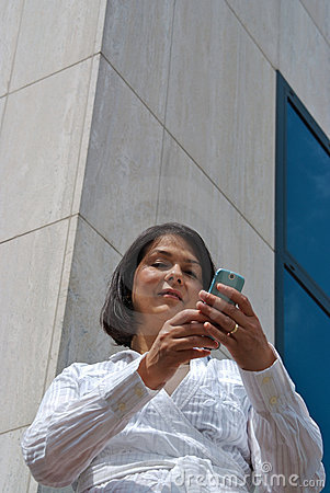 Businesswoman texting message with phone