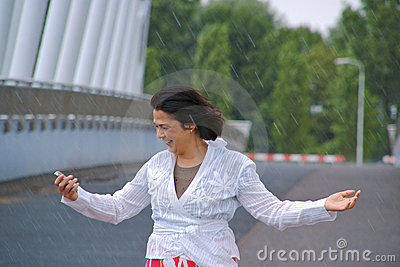 Woman in the rain looking at her phone display