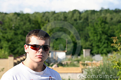 A young man in glasses
