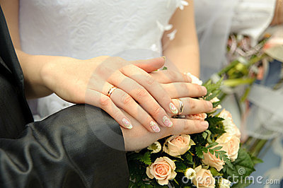 Hands of a newly-married couple