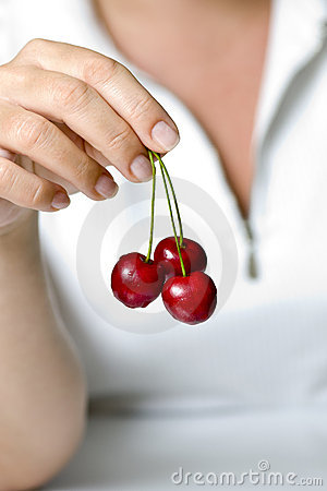 Cherries in fingers