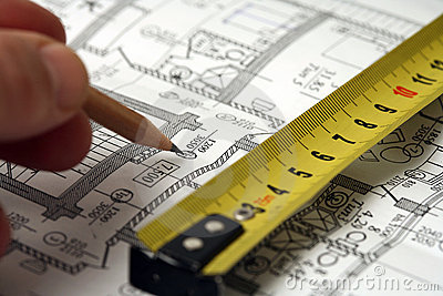 Man's hand draws a pencil business plan