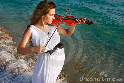 Girl playing violin on sea background
