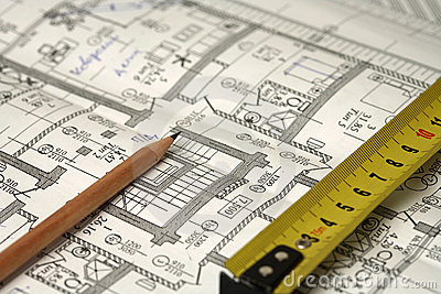 Pencil, ruler and a business plan