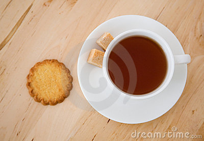 Cup of tea, sugar and biscuits