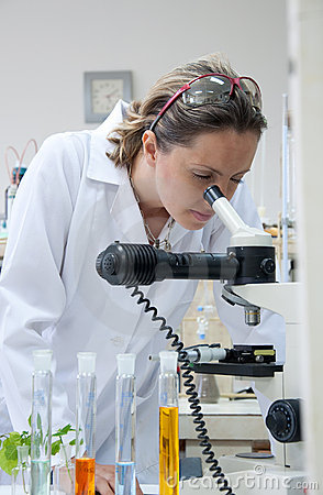 Scientist looking into a microscope