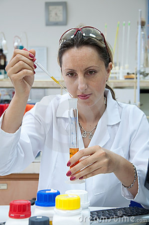 Researcher holds pipette
