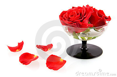 Glass with red roses and red leaves