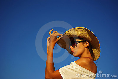 Young beautiful girl in the hat