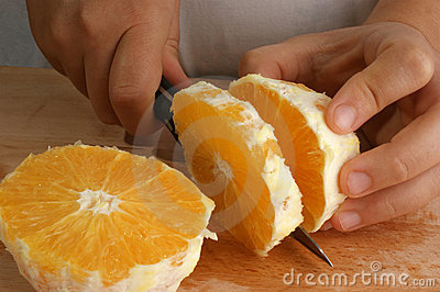 Prepare one orange to make fruitsalad