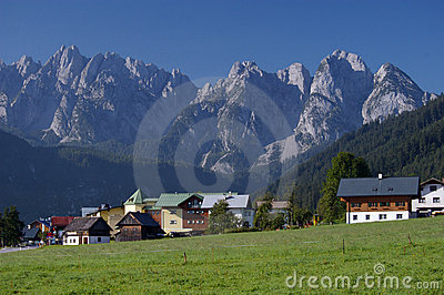 Village in alps with mountain ridge in background