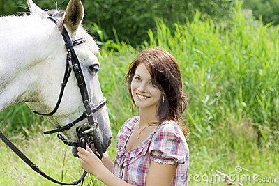 Brunette girl with horse