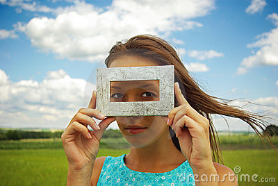 A beautiful young woman creates a frame