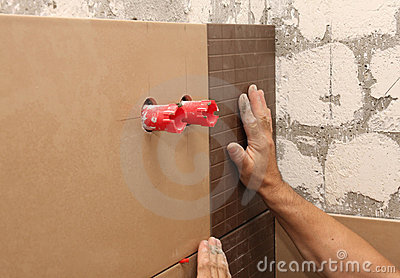 Laying ceramic tile on wall
