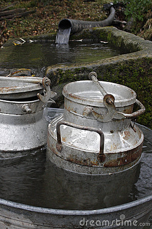 Two milk-churns in the tub