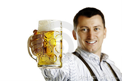 Bavarian man hold beer stein at Oktoberfest