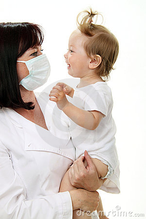 Smiling baby with doctor